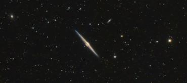 Galaktyki pomiędzy galaktykami (NGC4559 / NGC4565)